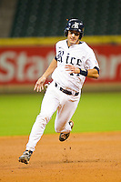 J.T. Chargois #14 of the Rice Owls hustles towards third base against the Kentucky Wildcats at Minute Maid Park on March 4, 2011 in Houston, Texas.  Photo by Brian Westerholt / Four Seam Images