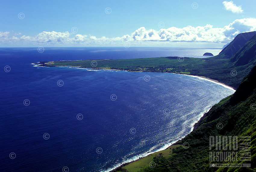 Aerial view of the Kalauapapa Peninsula with Mokapu Island (aka Sweetbread Rock) in the background. The location of a settlement used in historical times to isolate those with Hansen's disease.