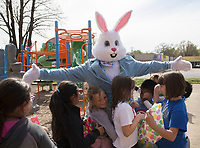 NWA Democrat-Gazette/CHARLIE KAIJO Attorney Kyle Heffley, dressed as the Easter bunny, hugs kids during an Easter egg hunt, Friday, April 12, 2019 at the Boys and Girls Club in Rogers. <br /> <br /> The Mitchell Williams Law Firm gave the Boys and Girls club of Rogers a $15,000 grant and held an egg hunt for the kids of the club. They offer grants each year through a program called Take Time To Give. The purpose is to encourage the law staff to do charitable work said Kyle Heffley, an attorney from the firm. <br /> <br /> The Boys and Girls club has five facilities in the county serving 150-200 kids at each site. The clubs experience a lot of wear-and-tear. Contributions from community organizations help the staff to focus on serving the kids.