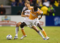 LA Galaxy defender Gregg Berhalter battles   Houston Dynamo forward Dominic Oduro during the Western Conference Final. The LA Galaxy defeated the Houston Dynamo 2-1 to win the MLS Western Conference Final at Home Depot Center stadium in Carson, California on Friday November 13, 2009.....