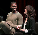 "Tarell Alvin McCraney, playwright of ""Wig Out!"" and Oscar award winning playwright and screenwriter for ""Moonlight,"" left, and Lisa Portes, head of Directing at The Theatre School, talk with students, faculty and staff from the set of ""Wig Out!"" on the Fullerton Stage in The Theatre School building, Friday, April 21, 2017. (DePaul University/Jeff Carrion)"