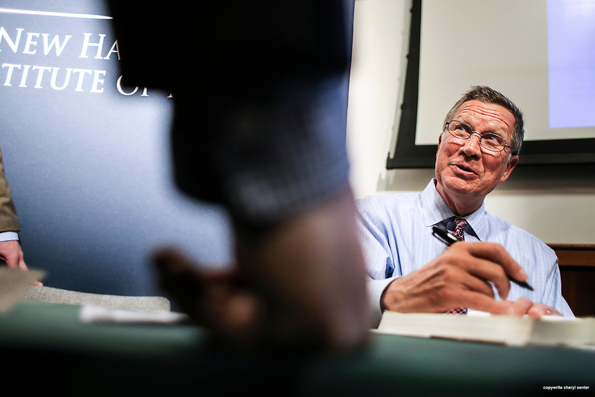 "Ohio Governor John Kasich holds a book signing after discussing his new book ""Two Paths: America Divided or United"" at The New Hampshire Institute of Politics at Saint Anselm College in Goffstown, N.H. Thursday, April 26, 2017. CREDIT: Cheryl Senter for The Boston Globe"
