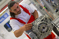 Worker inspects an E-Engine production starts at the Audi factory in Gyor (about 120 km West of Budapest), Hungary on July 24, 2018. ATTILA VOLGYI