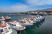 County Kerry, Ireland: Fishing boats in Portmagee Channel with Portmagee village in the background