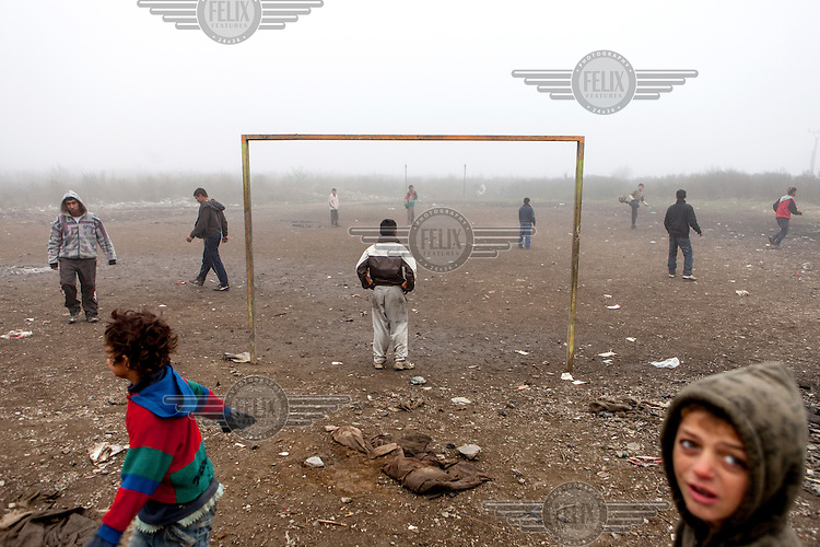 Young boys palying on a football pitch in the Roma settlement located in 'Budulovskej Street'.