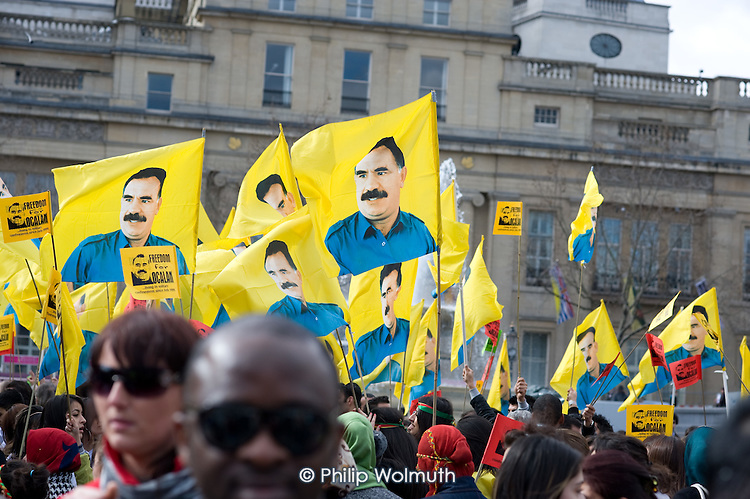 Flags bearing the image of Abdullah Ocalan, jailed founder of the Turkish Kurdish Workers Party (KPP), at a Kurdish New Year celebration, Trafalgar Square, London.