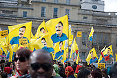 Flags bearing the image of Abdullah Ocalan, jailed founder of the Turkish Kurdish Workers Party (KPP), at a Kurdish New Year celebration, Trafalgar Square, London.