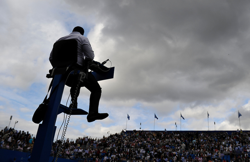 A silhouette of the Umpire on Centre Court<br /> <br /> Photographer Ashley Western/CameraSport<br /> <br /> Tennis - ATP 500 World Tour - AEGON Championships- Day 3 - Wednesday 17th June 2015 - Queen's Club - London <br /> <br /> &copy; CameraSport - 43 Linden Ave. Countesthorpe. Leicester. England. LE8 5PG - Tel: +44 (0) 116 277 4147 - admin@camerasport.com - www.camerasport.com