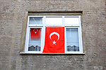 People display national flags to mark the Youth and Sports Day in Istanbul on May 19, 2020 during a four-day curfew aimed at curbing the spread of the COVID-19 pandemic, caused by the novel coronavirus. Photo by Mahmoud abu Salama