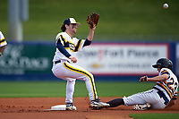 Michigan Wolverines shortstop Michael Brdar (9) waits for a throw as John Conti (23) slides into second base during the first game of a doubleheader against the Canisius College Golden Griffins on June 20, 2016 at Tradition Field in St. Lucie, Florida.  Michigan defeated Canisius 6-2.  (Mike Janes/Four Seam Images)