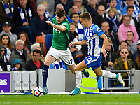 Brighton &amp; Hove Albion's Solly March (right) battles with West Bromwich Albion's Oliver Burke (left) <br /> <br /> Photographer David Horton/CameraSport<br /> <br /> The Premier League - Brighton and Hove Albion v West Bromwich Albion - Saturday 9th September 2017 - The Amex Stadium - Brighton<br /> <br /> World Copyright &copy; 2017 CameraSport. All rights reserved. 43 Linden Ave. Countesthorpe. Leicester. England. LE8 5PG - Tel: +44 (0) 116 277 4147 - admin@camerasport.com - www.camerasport.com
