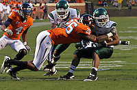 Oct 23, 2010; Charlottesville, VA, USA;  Virginia Cavaliers linebacker Ausar Walcott (26) tackles Eastern Michigan Eagles running back Javonti Greene (32) during the game at Scott Stadium.  Virginia won 48-21. Mandatory Credit: Andrew Shurtleff