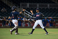 AZL Indians 2 catcher Felix Fernandez (9) and relief pitcher Jerson Ramirez (63) celebrate a victory after an Arizona League game against the AZL Dodgers at Goodyear Ballpark on July 12, 2018 in Goodyear, Arizona. The AZL Indians 2 defeated the AZL Dodgers 2-1. (Zachary Lucy/Four Seam Images)