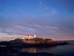 Cape Neddick - Nubble - Light Station (1879) in sunset light with clearing storm clouds<br /> York County, ME