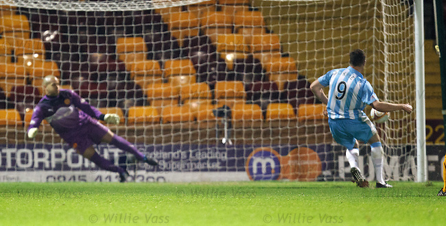 Kevin Kyle dispatches his penalty kick past Darren Randolph