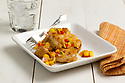 Crab cakes served with corn and red pepper relish