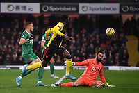 1st January 2020; Vicarage Road, Watford, Hertfordshire, England; English Premier League Football, Watford versus Wolverhampton Wanderers; Ismaila Sarr of Watford under pressure from Romain Saiss of Wolverhampton Wanderers chips the keeper but is unable to score the goal as the ball hits the side netting - Strictly Editorial Use Only. No use with unauthorized audio, video, data, fixture lists, club/league logos or 'live' services. Online in-match use limited to 120 images, no video emulation. No use in betting, games or single club/league/player publications