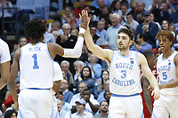 CHAPEL HILL, NC - FEBRUARY 25: Andrew Platek #3 and Leaky Black #1 of the University of North Carolina high five each other during a game between NC State and North Carolina at Dean E. Smith Center on February 25, 2020 in Chapel Hill, North Carolina.