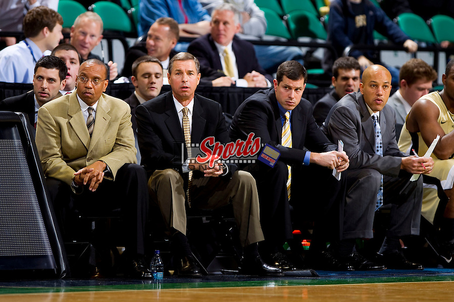 (L-R) The Wake Forest Demon Deacons coaching staff, Jeff Battle, Jeff Bedzelik, Rusty LaRue and Walt Corbean, watch the game action against the UNC-Wilmington Seahawks at the Greensboro Coliseum on December 12, 2010 in Greensboro, North Carolina.  The Seahawks defeated the Demon Deacons 81-69. Photo by Brian Westerholt / Sports On Film