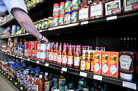 A resident stocks shelves at TROSA's grocery store in east Durham.