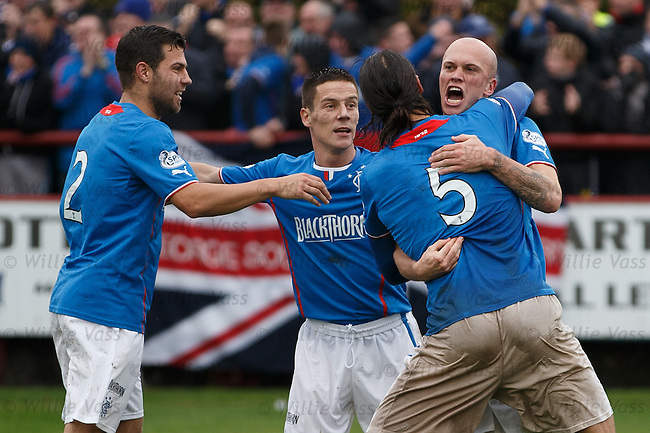 Nicky Law swamped as Rangers celebrate his goal