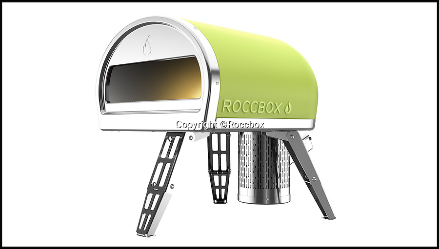 BNPS.co.uk (01202 558833)<br /> Pic: Roccbox/BNPS<br /> <br /> Forget barbecues in the park this summer - pizzas could soon be the in thing to cook at gatherings after a British inventor launched the world's first portable pizza oven.<br /> <br /> Just like a barbecue the lightweight device can be thrown into the boot of a car and taken to parks and campsites - but instead of grilling food it uses wood or gas to heat up its authentic stone base to blistering temperatures.<br /> <br /> Called the Roccbox, the invention is the brainchild of entrepreneur Tom Gozney, who launched his wood-fired pizza oven business six years ago after finding he couldn't cook a crispy pizza in his conventional oven.<br /> <br /> Tom, 30, from Lymington, Hants, has spent three years developing his pioneering portable pizza oven, and is now looking for backing from Virgin boss Sir Richard Branson via the billionaire's 'Pitch to Rich' scheme where the public vote for enterprising inventions.