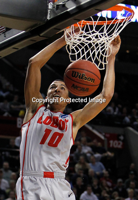 University of New Mexico guard Kendall Williams dunks against Long Beach State during their men's NCAA basketball game in Portland, Oregon,  March 15, 2012.  REUTERS/Steve Dipaola (UNITED STATES)