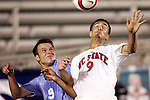 9 November 2005: North Carolina State's Bryant Salter (right) rises over North Carolina's Michael Harrington (left) for a header. The University of North Carolina defeated North Carolina State University 1-0 at SAS Stadium in Cary, North Carolina in a quarterfinal of the 2005 ACC Men's Soccer Championship.