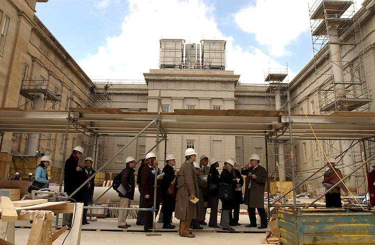 Members of the media are taken though the courtyard of the National Portrait Gallery and the Smithsonian American Art Museum, during a walk through of the site that is scheduled to open July 1, 2006, after a six year renovation project.