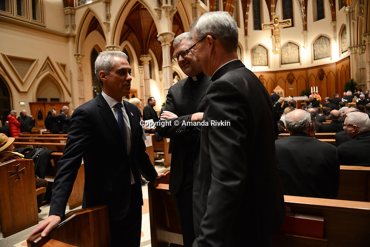 Mayor Rahm Emanuel greets DePaul University President Dennis H. Holtschneider (center) and an unidentified priest as priests from Chicago and around the nation and world arrive for the mass ahead of the installation ceremony of the Archbishop-elect of Chicago, Blase Cupich, at Holy Name Cathedral in Chicago, Illinois on November 18, 2014.  Cupich is the ninth Archbishop of Chicago and succeeds Cardinal Francis George.