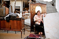 Chile, Aftermath of the tsunami in the area of Consitucion. antonieta Bianchi (47) outside of what is left of her house.