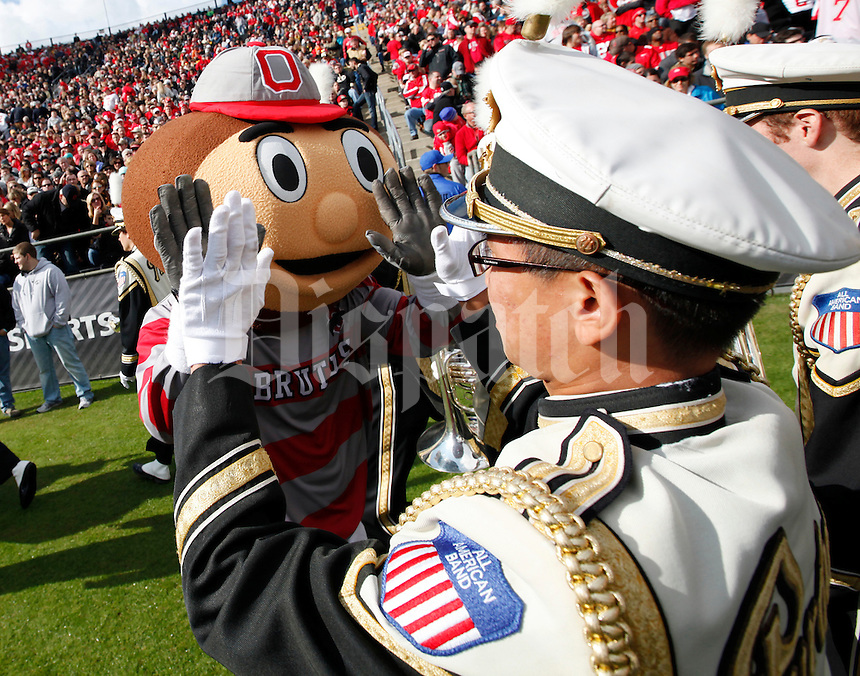 Brutus Buckeye high fives a member of the Purdue Marching Band during the second half of the NCAA football game at Ross-Ade Stadium in West Lafayette, Ind. on Nov. 2, 2013. (Adam Cairns / The Columbus Dispatch)