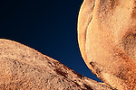 Abstract of round rocks and blue sky