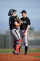 Edgewood Eagles catcher Garrett Bogucki (25) talks with pitcher Adam Eck (26) during the first game of a doubleheader against the Plymouth State Panthers on April 17, 2016 at Lee County Player Development Complex in Fort Myers, Florida.  Plymouth State defeated Edgewood 6-5.  (Mike Janes/Four Seam Images)