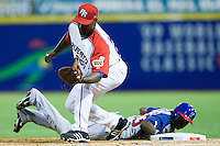 7 March 2009: #63 Luis Durango of Panama is safe at first as #21 Carlos Delgado of Puerto Rico catches the ball during the 2009 World Baseball Classic Pool D match at Hiram Bithorn Stadium in San Juan, Puerto Rico. Puerto Rico wins 7-0 over Panama.