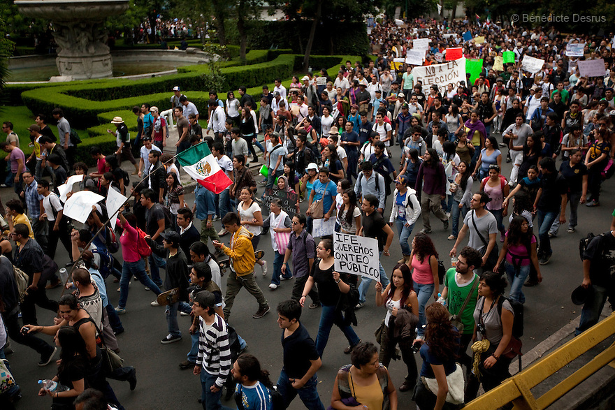 "2 July 2012 - Mexico City, Mexico - Thousands of demonstrators and university students who are members of the movement ?yo soy 132? (I am 132) march during a demonstration in Mexico City a day after the presidential election. The movement is protesting against The Federal Electoral Institute and against Mexican President-elect Enrique Pena Nieto, candidate of the Institutional Revolutionary Party (PRI), who claimed victory in the presidential election, after first official results showed him with 38 percent of the vote. Mexican leftist presidential candidate Andres Manuel Lopez Obrador said he would challenge the outcome of Sunday's election if results that he said were ""plagued by irregularities"" were confirmed. Photo credit: Benedicte Desrus"