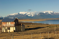 A typical gaucho dwelling looks over part of Lago Argentino towards the mountains surrounding the Perito Moreno Glacier in Argentina. Although not the longest or the widest or the highest glacier in Argentina, Perito Moreno enjoys star status.