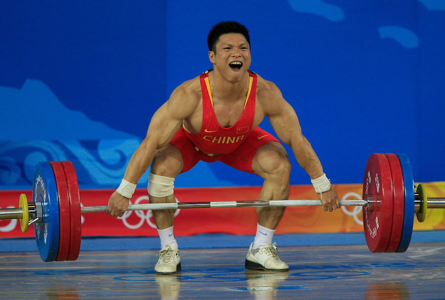 Li Hongli of China, reacts after successfully tackling his lift in the men's 77-kilogram weightlifting final during day five of the 2008 Beijing Olympics in Beijing, China, on Wednesday, Aug. 13, 2008.