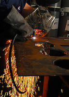 Using a plasma torch to cut steel aboard USS Abraham Lincoln.