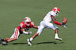 Wisconsin Badgers defensive back Devin Smith (10) defends against Fresno State Bulldogs wide receiver Marlon Moore (5) as he bobbles the ball during an NCAA football game on September 12, 2009 in Madison, Wisconsin. The Badgers won in double overtime 34-31. (Photo by David Stluka)