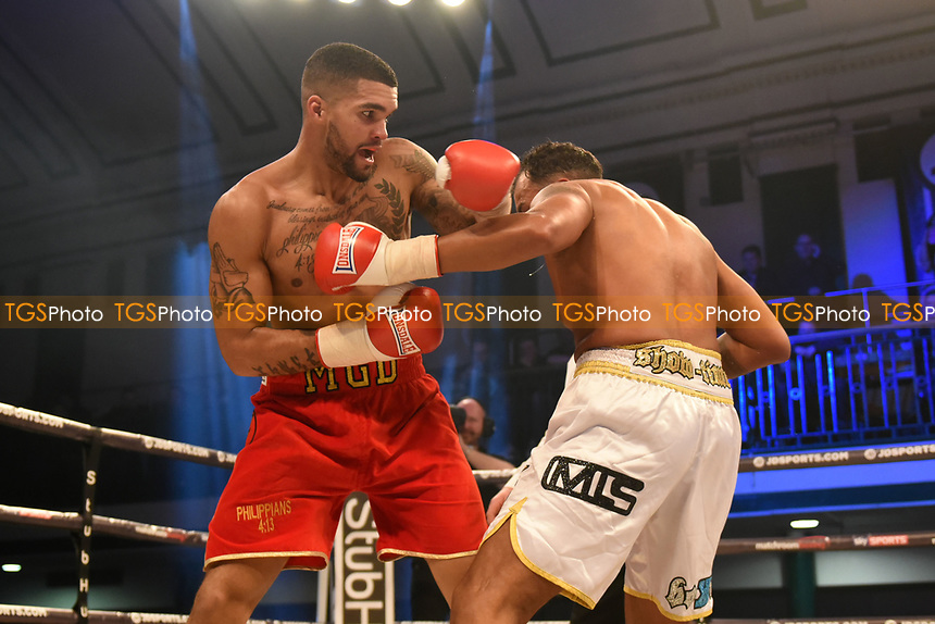 Milles Gordon Darby (red shorts) defeats Jamie Ambler during a Boxing Show at York Hall on 17th March 2017