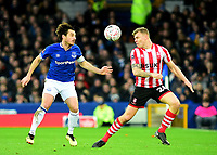 Lincoln City's Harry Anderson vies for possession with  Everton's Leighton Baines<br /> <br /> Photographer Andrew Vaughan/CameraSport<br /> <br /> Emirates FA Cup Third Round - Everton v Lincoln City - Saturday 5th January 2019 - Goodison Park - Liverpool<br />  <br /> World Copyright &copy; 2019 CameraSport. All rights reserved. 43 Linden Ave. Countesthorpe. Leicester. England. LE8 5PG - Tel: +44 (0) 116 277 4147 - admin@camerasport.com - www.camerasport.com