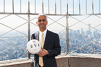 U.S. Soccer president Sunil Gulati poses for a photo on the observation deck of the Empire State Building during the centennial celebration of U. S. Soccer in New York, NY, on April 05, 2013.