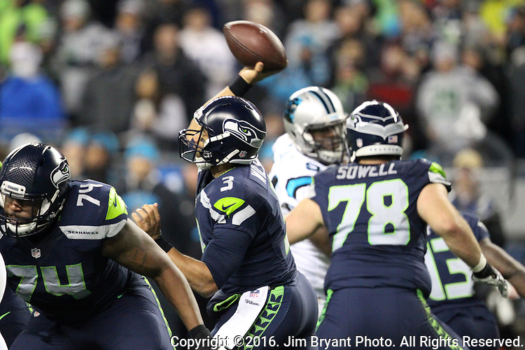 Seattle Seahawks quarterback Russell Wilson (3) passes against the Carolina Panthers at CenturyLink Field in Seattle, Washington on December 4, 2016.  Seahawks beat the Panthers 40-7.  ©2016. Jim Bryant photo. All Rights Reserved.