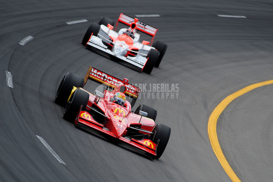 Jun. 21, 2008; Newton, IA, USA; IRL driver Justin Wilson leads Helio Castroneves during practice for the Iowa Corn Indy 250 at the Iowa Speedway. Mandatory Credit: Mark J. Rebilas-
