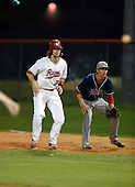 Lake Mary Rams shortstop Brendan Rodgers (3) leads off first behind first baseman Paxton Rigby (22) during a game against the Lake Brantley Patriots on April 2, 2015 at Allen Tuttle Field in Lake Mary, Florida.  Lake Brantley defeated Lake Mary 10-5.  (Mike Janes Photography)