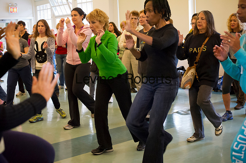 Women participate in a free self-defense class in Central Park in New York on Sunday, October 7, 2012 .  The class was organized by the NY City Council and taught by instructors from the Center for Anti-Violence Education. The women learned techniques to protect themselves from attack. (© Frances M. Roberts)