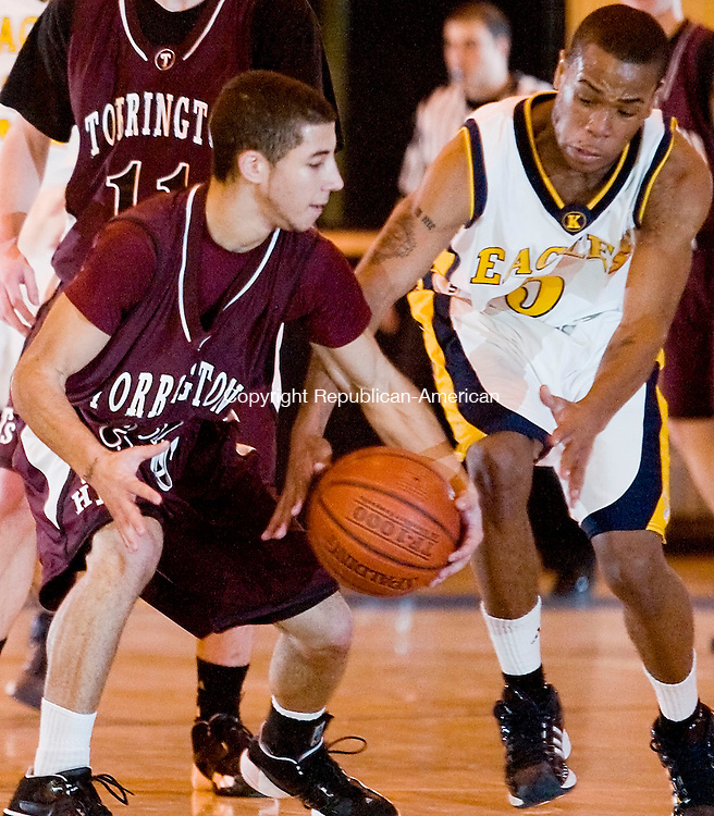 WATERBURY, CT--04 January 08--010408TJ03 - Kennedy's Marcus Johnson (5) tries to steal the ball from Torrington's Andre French during Torrington High School's 43-40 victory over John F. Kennedy High School on Friday, January 4, 2008. T.J. Kirkpatrick/Republican-American