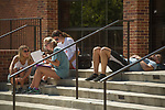 Keaton Cook, left, Elizabeth Quirk and Sarah Pierce study organic chemistry while waiting for a lab.  Kurt Pollack, right, waiting for the same lab, takes it easy.  Photo by Kevin Bain/Ole Miss Communications