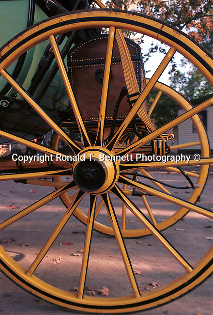 Carriage wheel Colonial Williamsburg Virginia, Colonial carriage, Colonial Williamsburg Virginia, horse drawn carriage, coach, horses clopping, coble stone streets, stage wagon, stable, historic area, Carriage wheel trundle beneath Duke of Gloucester Street, groomed horses, horses with polished harness brass leather for wear, horses to the carriages, blacksmith, harness, coachman, Fine Art Photography by Ron Bennett, Fine Art, Fine Art photography, Art Photography, Copyright RonBennettPhotography.com ©